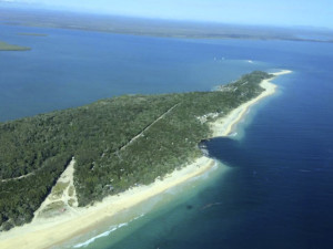 An image obtained Sunday, Sept. 27, 2015 of a 150-metre long and 50 metre wide sinkhole which opened up at MV Beagle Campground, north of Queensland's Rainbow Beach at Inskip Point. (AAP Image/Higgins Storm Chasing) NO ARCHIVING, EDITORIAL USE ONLY